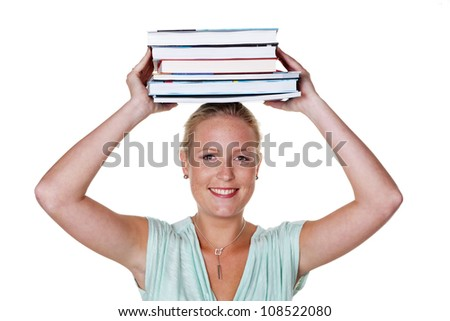 a young student at a university with a stack of books on her head
