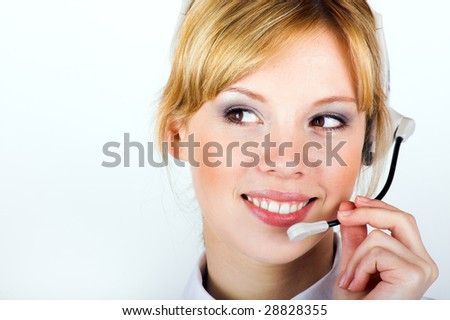 A young successful and happy business woman is calling with a headset