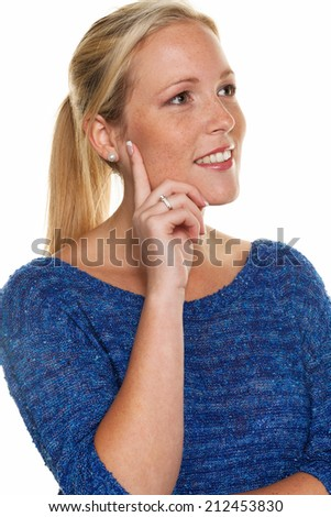 a young, sympathetic smiling woman in thoughtful pose. do not fear the future. know where to go - stock photo