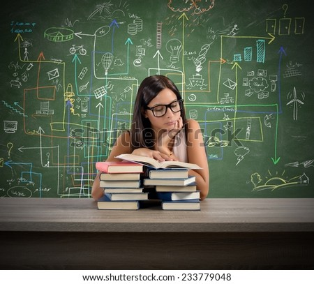 A young teacher concentrated reading a book - stock photo