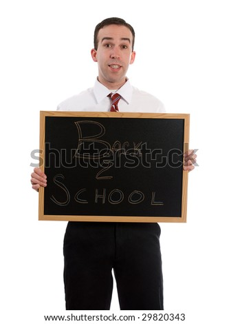 A young teacher is holding up a small black board that read Back to School, isolated against a white background - stock photo