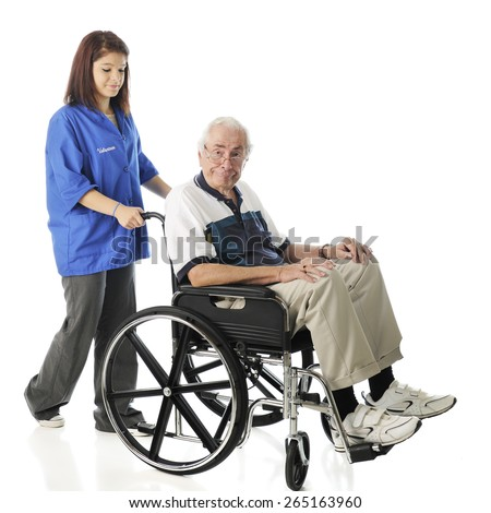 A young teen volunteer pushing an elderly man in his wheel chair.  On a white background.