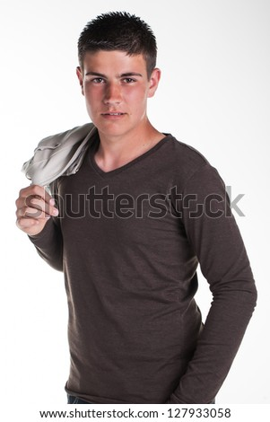 A young teenage boy being photographed in a studio. - stock photo