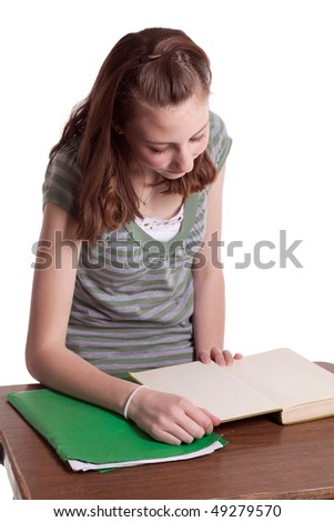 a young teenage girl doing her homework
