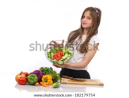 A young teenage girl holding a bowl of salad isolated on white - stock photo