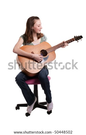 a young teenage girl playing a guitar