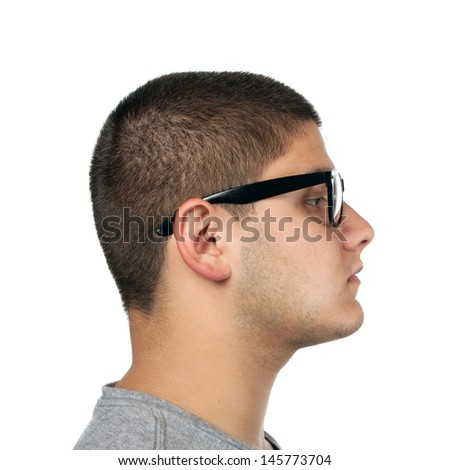 A young teenage man isolated over white wearing black frame nerd type vintage glasses. - stock photo