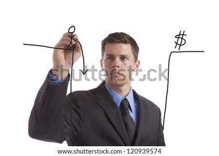 A young, tired businessman draws his idea of the coming fiscal cliff. - stock photo