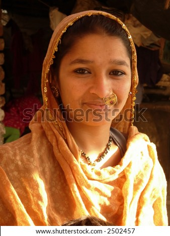 a young village girl posing in india - stock photo