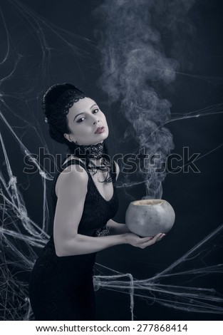 A young witch with magic potion - stock photo