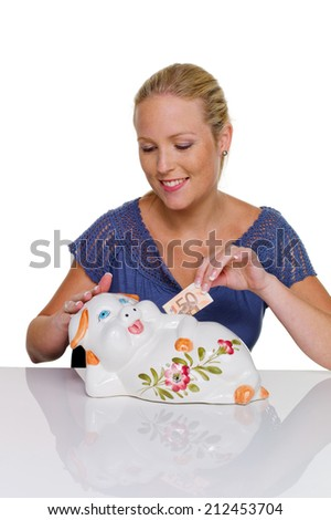 a young woman against white background holding a piggy bank. save money as a pension. - stock photo