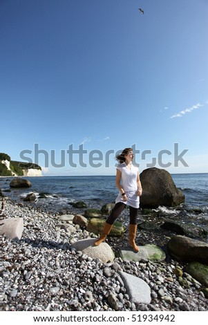 A young woman at the beach of the germen island R�¼gen