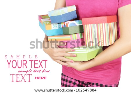 a young woman carrying a lot of gifts, isolated on white background - stock photo