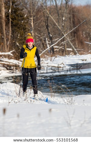 A young woman cross country skiing in Ontario, Canada.
