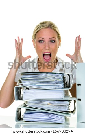 a young woman desperately in office between many file folders and crumpled papier.symbolfoto for stress, burnout and overwork. - stock photo