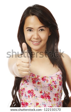 A young woman doing a thumbs up sign (isolated on white) - stock photo