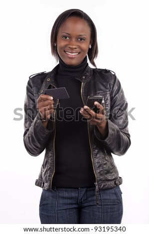 A young woman doing credit card transaction from her phone. - stock photo