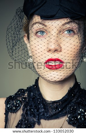 A young woman dressed in black in a scenario as a widow looking to the future - stock photo