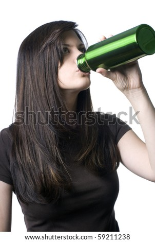 A young woman drinking out of a reusable water bottle.