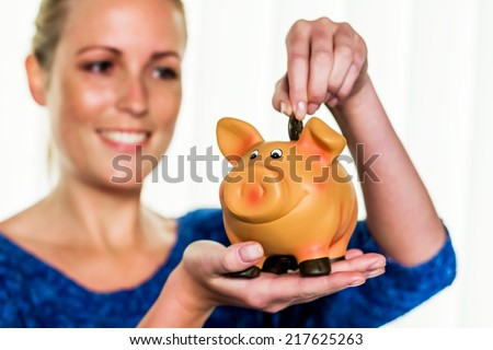 a young woman holding a piggy bank in her hand. , create photo icon for save money and retirement.