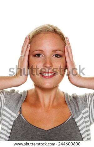 a young woman holds her ears. symbolic photo for not want to hear disputes and conflicts, as well as loud undtinnitus - stock photo