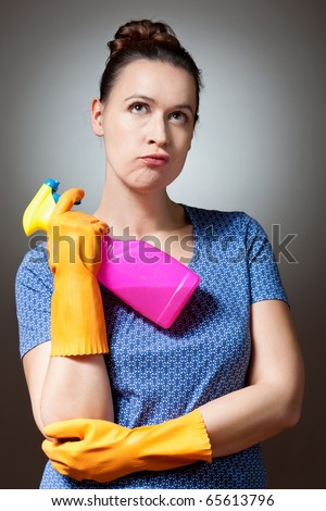 A young woman in a domestic role decision making. - stock photo