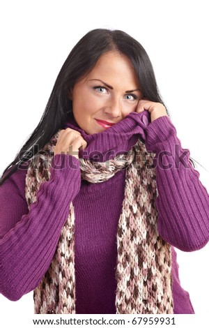 A young woman in a sweater isolated on white