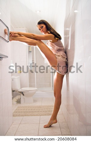 A young woman in the bathroom - stock photo