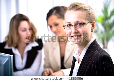 A young woman in the office - stock photo