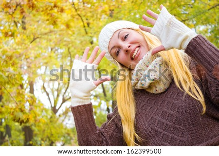 A young woman in the park enjoying the charms of autumn, Autumn,  photography