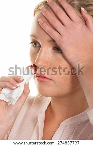 a young woman is bleeding from her nose. stops noses bleed with a handkerchief.