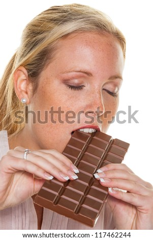 a young woman is enjoyable a chocolate bar - stock photo