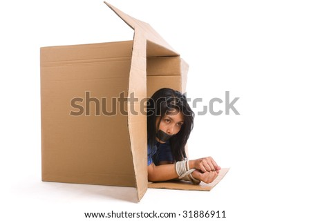 A young woman is trying to escape with her hand tied up. - stock photo
