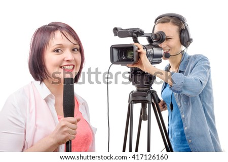 a young woman journalist with a microphone and camerawoman - stock photo
