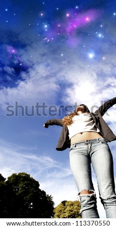A young woman jumping to the night sky. - stock photo