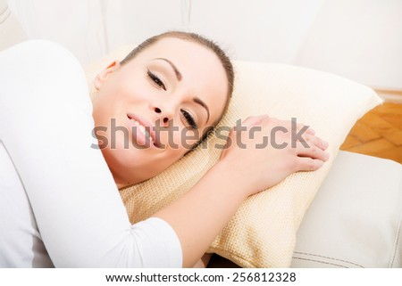 A young woman lying on the sofa.