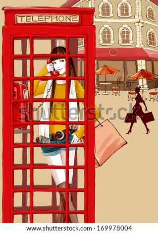 A young woman on the phone in a red booth. - stock photo