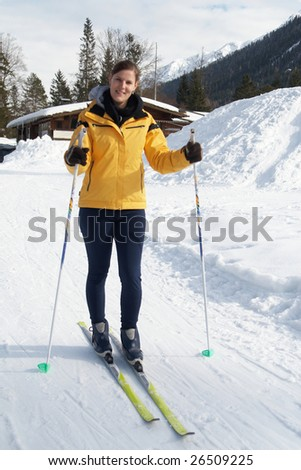 A young woman outdoor in a winter setting. The active woman is about to go crosscountry skiing. - stock photo