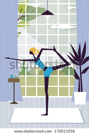 A young woman performs a yoga pose in front of a window. - stock photo