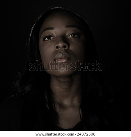 A young woman, photographed in the studio. - stock photo
