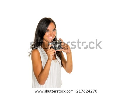 a young woman photographed with a retro camera - stock photo