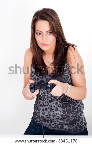 A young woman, playing video games - stock photo