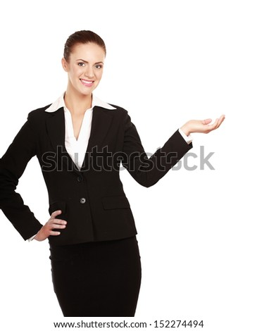 A young woman pointing at something, isolated on white background - stock photo