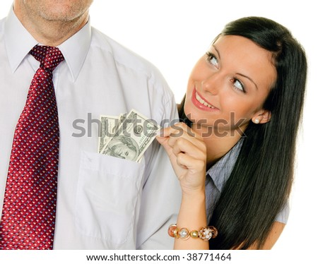 A young woman pulls a man out of the money Tasche.Dollar - stock photo