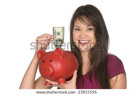 A young woman putting a one hundred dollar bill into her piggy bank