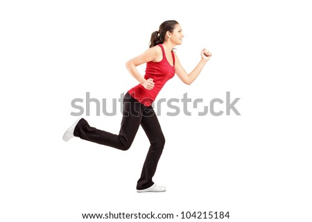 A young woman running isolated on white background - stock photo