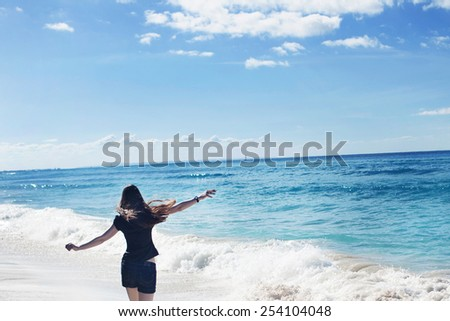 A young woman runs along the seacoast - stock photo