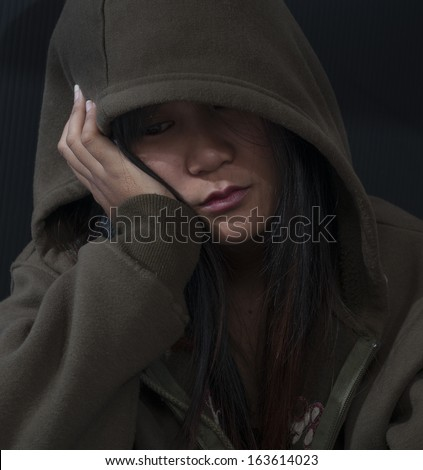 A young woman sad and depressed