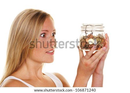 a young woman saves money and coins for the future. care and save. - stock photo