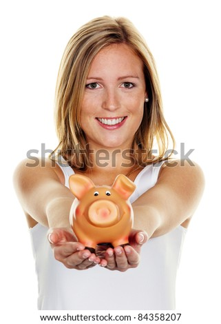 A young woman saves money and coins for the future. Pension and savings. - stock photo